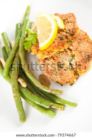Salmon and Sweet Potato Cakes with Green Beans - stock photo