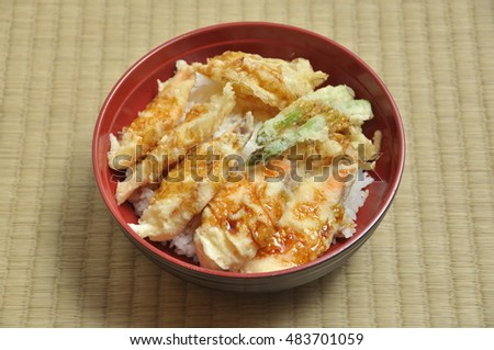 Salmon and vegetable tempura with rice in circle bowl on Tatami mat