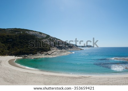 Salmon Beach Bay in Torndirrup National Park, Albany, Western Australia, burnt vegetation on cliff coast, turquoise Southern Ocean, blue sky, copy space. - stock photo