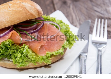 Salmon Bun on a plate against wooden background