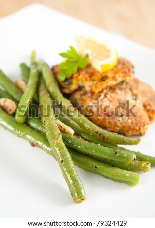 Salmon Cakes with Green Beans - stock photo