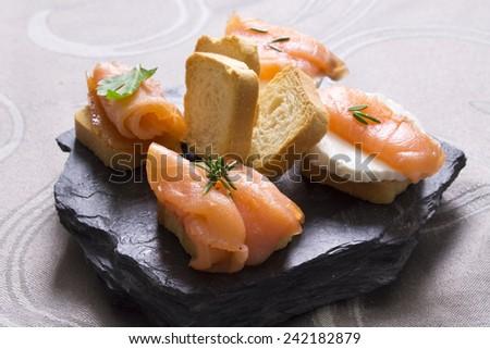salmon canapes - stock photo
