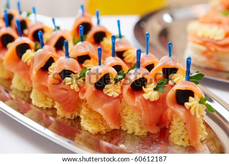 Salmon canapes, narrow focus - stock photo