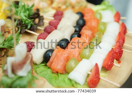 Salmon canapes on restaurant table, narrow focus depth - stock photo