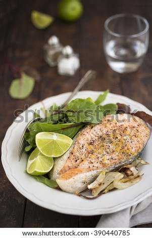 Salmon chop with greens and roasted fennel with lime - stock photo