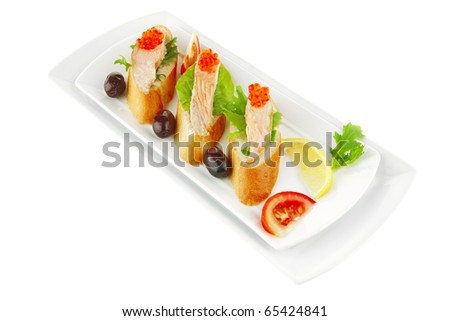 salmon chunks and caviar on baguette with olives