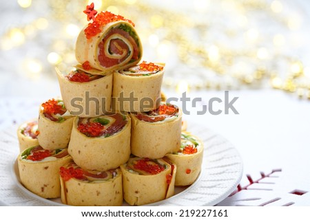 Salmon, cream cheese and iceberg lettuce pinwheels for Christmas - stock photo