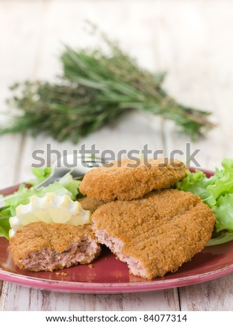 salmon croquettes with green salad - stock photo