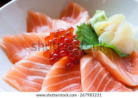 Salmon egg sashimi sushi put into white bowl - stock photo
