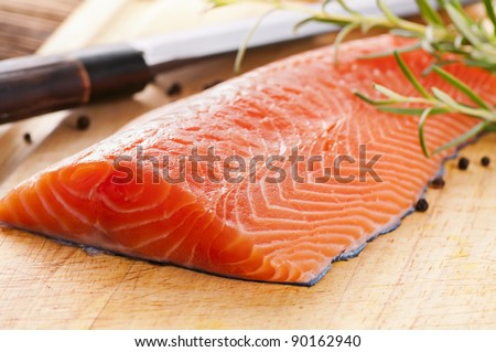 salmon filet with fresh herbs - stock photo
