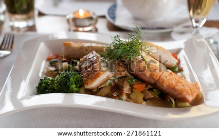 Salmon fillet dish with fresh vegetables and potatoes - stock photo