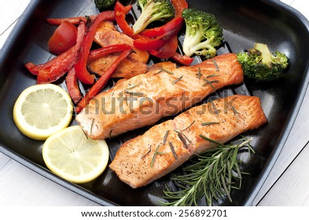 Salmon fillet on grill pan  - stock photo
