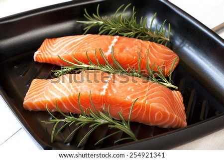 Salmon fillet on grill pan ready to cook - stock photo