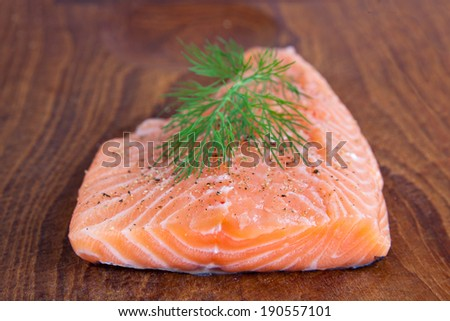 Salmon fillet with herbs - stock photo