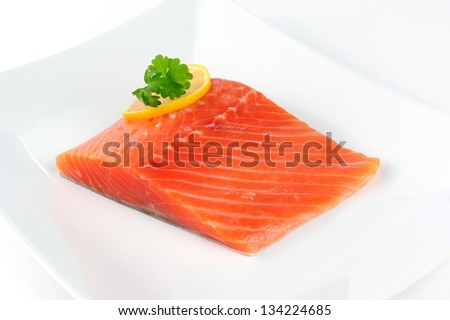 Salmon Fillet with Lemon and Parsley on Plate - stock photo