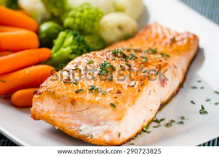 Salmon fillet with mixed vegetables - stock photo