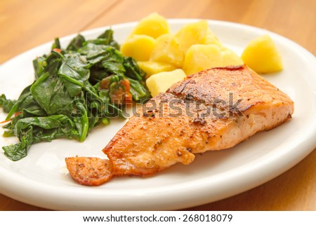 Salmon fillet with spinach and potatoes - stock photo