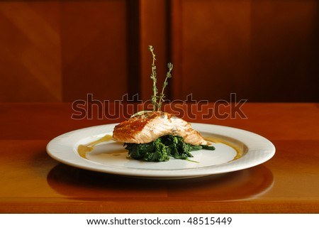 salmon fillet with spinach and thyme - stock photo