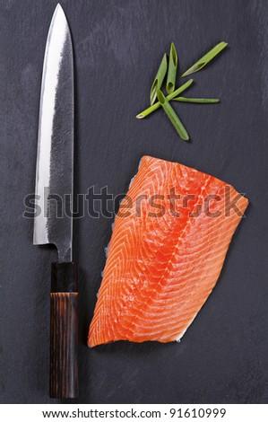 salmon fillet with yanagiba knife - stock photo