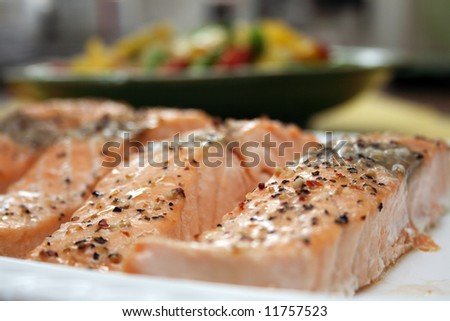Salmon fillets baked in oven served with vegetables - stock photo