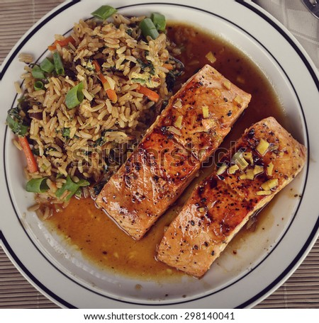 Salmon Fillets with Orange Sauce and Rice with Mushrooms - stock photo