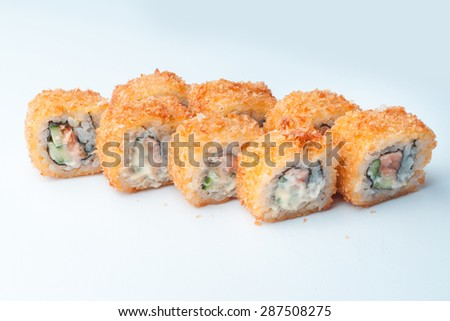 salmon fish cucumber breadcrumbs sushi rolls batter hot - stock photo
