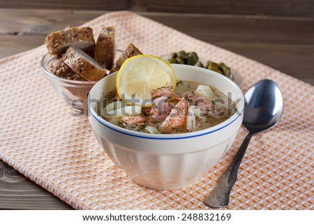Salmon fish soup in a bowl - stock photo