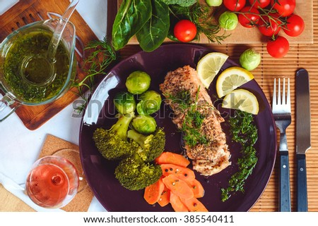Salmon fish with vegetables top view - stock photo