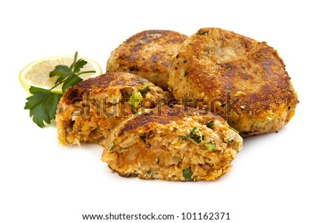 Salmon fishcakes or patties, with lemon and parsley, isolated on white background. - stock photo