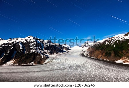 Salmon Glacier at Hyder Alaska, moonlight and star trail - stock photo
