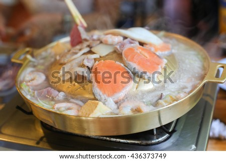 salmon grill in frying pan - stock photo