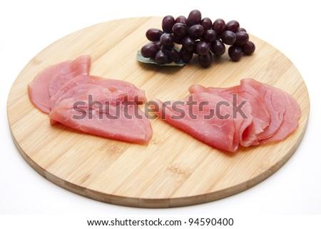 Salmon ham with grapes - stock photo