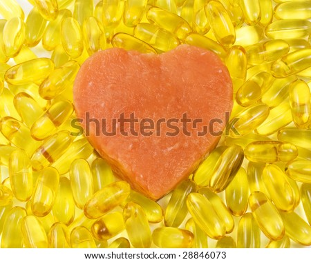 salmon heart surrounded by salmon oil - stock photo