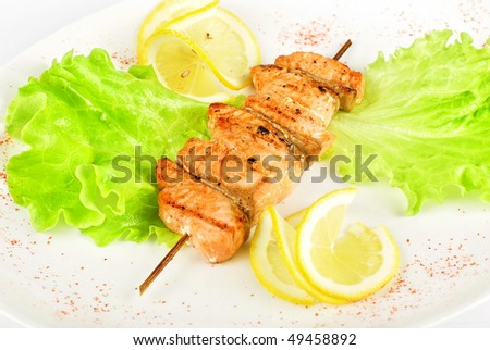 salmon kebab closeup at plate isolated on a white background - stock photo