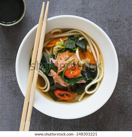 Salmon Noodle Soup and A Cup of Green Tea. - stock photo