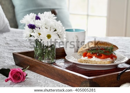 Salmon on Ciabatta Breakfast in and flowers served in bed for Mother's Day. - stock photo