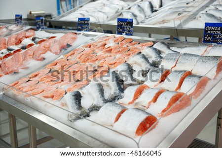 Salmon on cooled market display, tm's removed from price tags - stock photo
