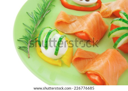 salmon on green dish with boiled eggs - stock photo
