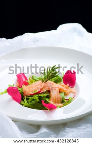 Salmon on rocket salad
