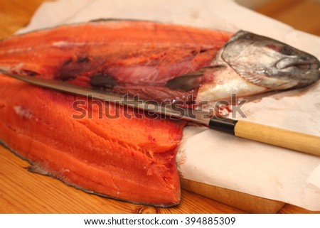 salmon on the sheet of baking paper in the course of preparation