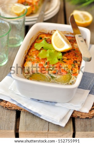 Salmon (or trout), cheese and vegetable bake - stock photo