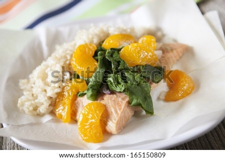 Salmon Packets with mandarin oranges, spinach and shallots - stock photo