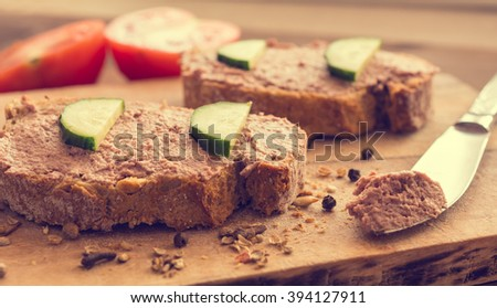 Salmon pate on bread and wooden background - stock photo