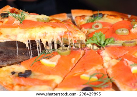 Salmon pizza hot and ready to eat. - stock photo