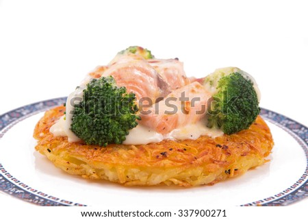 Salmon Rosti Served With Boiled Broccoli And White Bechamel Sauce Potato Dish From Swiss