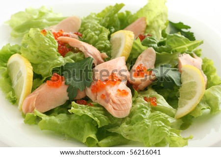 salmon salad with caviar and lemon