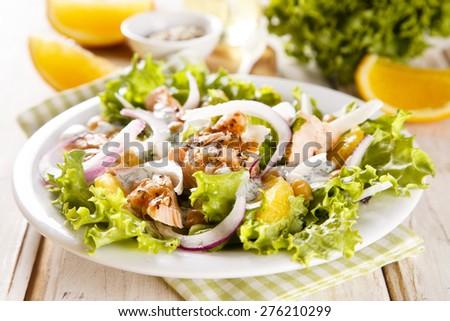 Salmon salad with orange, onion and chickpeas - stock photo
