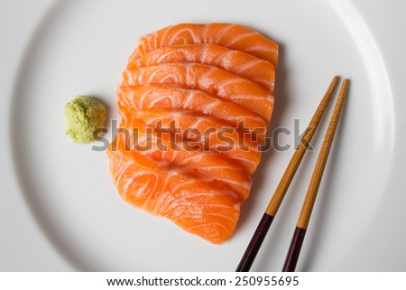 Salmon sashimi, japanese food in plate with wasabi and chopstick. - stock photo