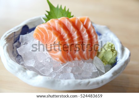 salmon sashimi on wood background , Japanese food