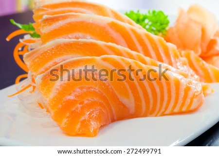 Salmon sashimi or shake / sake served with preserved ginger - stock photo
